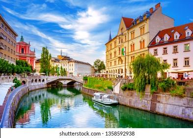 Slovenia Ljubljana Tromostovje Ljublianica river Church
