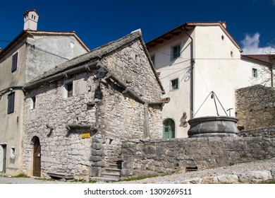 Štanjel, Slovenia - March 24 2016: Kraška hiša (Karsthouse) in the historic town of Štanjel. Built in 14th or 15th century. Made of limestone including its roof and eaves. Currently used as a museum.