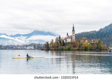 Slovenia, NOV 3: Beautiful autumn landscape around Lake Bled with Pilgrimage Church of the Assumption of Maria with man kayaking on NOV 3, 2018 at Slovenia