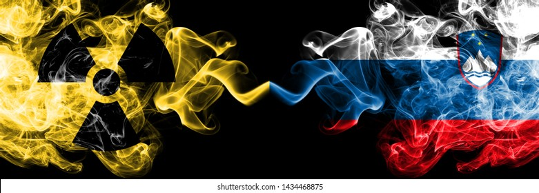 Slovenia, Slovenian vs nuclear smoky mystic flags placed side by side. Thick colored silky smokes combination of Slovenia, Slovenian flag and radioactive sign.