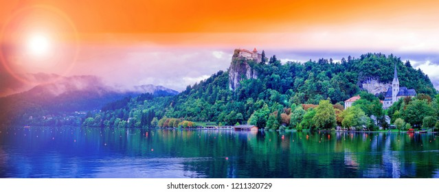 Slovenia travel Bled lake,Bled castle, top of the rock mountain and st. Martin's church the destination of Slovenia Eastern Europe.evening time.with effect of the sunset.