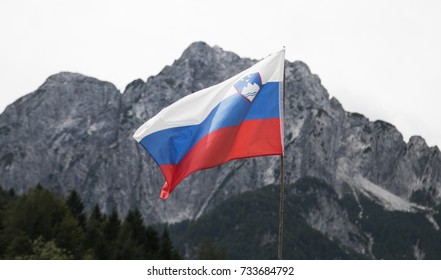 Slovenian Flag with Mountains in the backgroud
