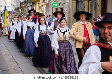 Slovenian Folklore group in local costume walking down in couples the streets of Lviv during opening the Parade of Etnovyr Festival in street of Lviv. Lviv, Ukraine - August 22, 2019