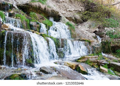 Slovenian Keys waterfall out of the ground. Illuminated source. Living water. Izborsk. Pskov. Russia. Travels.