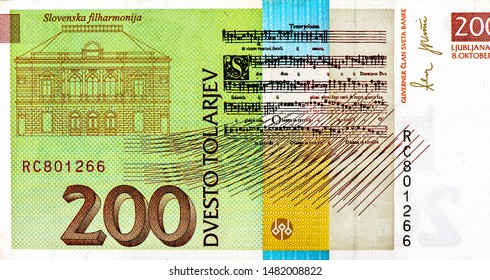 Slovenian Philharmonic Hall; Musical notes.portrait from Slovenian 200 Tolarjev 2004 banknotes, Slovenian money. Close Up UNC Uncirculated - Collection.