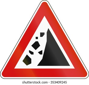 Slovenian road warning sign - Falling rocks on the right.