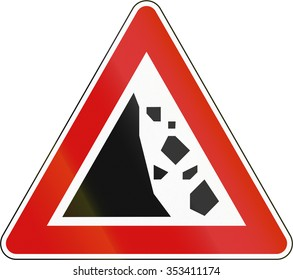 Slovenian road warning sign - Falling rocks on the left.