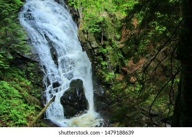 Slovenian waterfall in the green forest