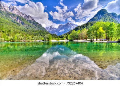 Slovenia's spring landscape reflected in the lake, next to the italian border