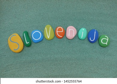 Slovenija, european country, souvenir with a composition of multi colored stones over green sand