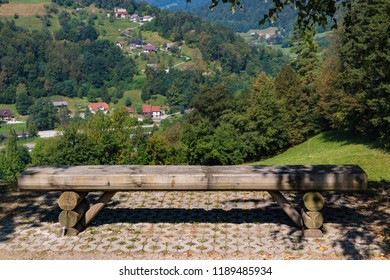 Slovenija landscape: bench close up with scenic view on green valley. Lasko