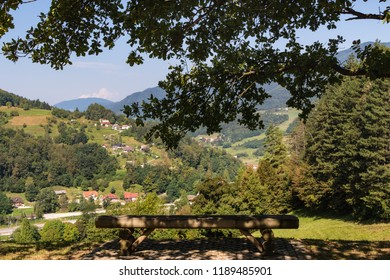 Slovenija landscape: bench with scenic view on green valley. Lasko