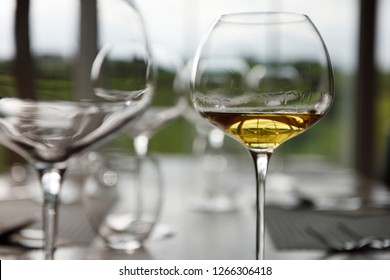 Slovrenc, Brda, Slovenia - June 17, 2017: Glass of Amphora white wine at a wine tasting in dining room of Kabaj Morel Guest House  and winery Slovrenc Dobrovo Brda Slovenia