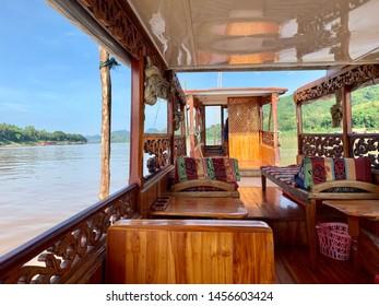 Slow Boat Cruising on the Mekong River in Luang Prabang, Laos