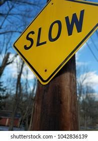 Slow caution street sign, yellow