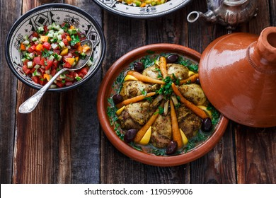 Slow cooked chicken with carrots, morrocan tajine, rustic style