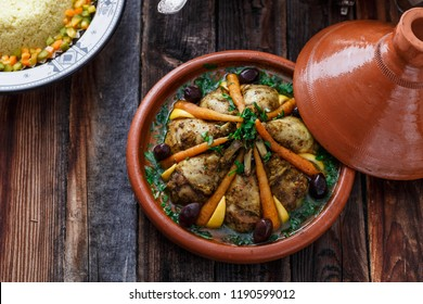 Slow cooked chicken with carrots, morrocan tajine, copy space.