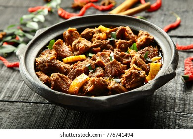 Slow cooked goat meat curry roast.