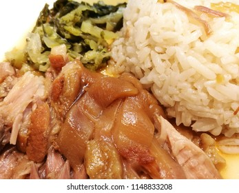 Slow cooked pork leg with steamed rice ,topped with some pickled mustard green.