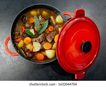 Slow Cooker Boeuf bourguignon (Beef bourguignon) beef stew braised in red wine with carrots, onions, garlic, French cuisine, Eat Well concept.