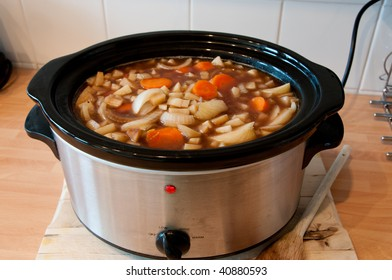 Slow cooker cooking Scouse with the lid off showing the stew cooking, cheep winter cooking