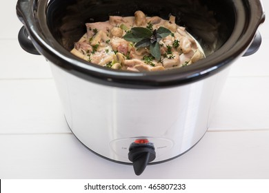 Slow cooker crockpot casserole meal with chicken, bacon and fresh herbs.