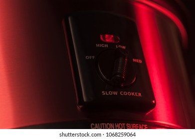 Slow Cooker detail shot in studio, working and glowing red