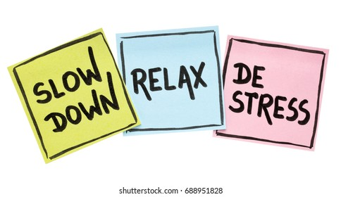 slow down, relax, de-stress concept -  motivational lifestyle reminders on colorful sticky notes