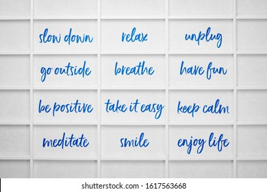 slow down, relax, take it easy, keep calm and other motivational lifestyle reminders on rice paper screen, healthy living concept