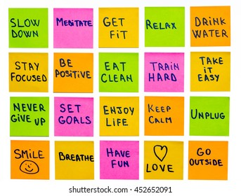 slow down, relax, take it easy, keep calm, love, meditate, go outside, enjoy life, be positive, have fun, unplug, breathe and other motivational lifestyle reminders on colorful sticky notes