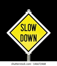 Slow Down yellow road sign isolated over black (clipping path included)