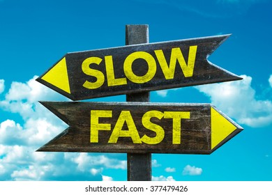 Slow - Fast signpost with sky background