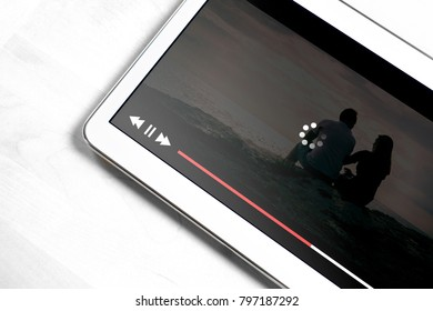 Slow internet connection. Bad online movie streaming service. Loading icon rolling on video. Film player stopped and buffering. Problem with wifi.