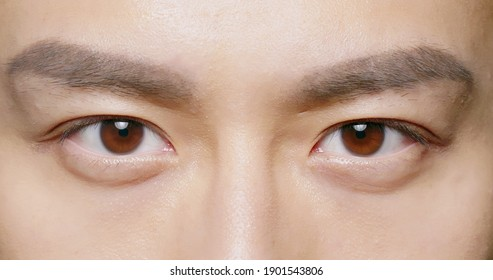 slow motion of male eye close up from asian young man - Shutterstock ID 1901543806