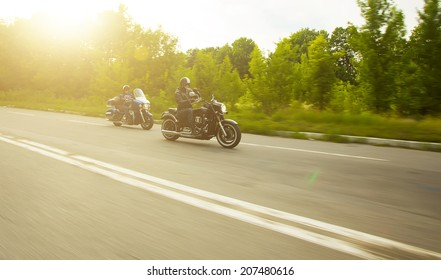 slow motion, two bikers riding unknown motorbike with blur movement, speed concept