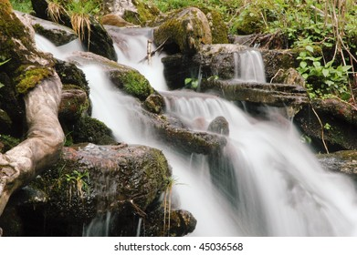 Slow moving waterfall over rocks in spring