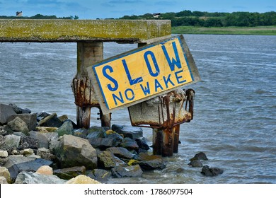 Slow No Wake sign on Cape May Canal