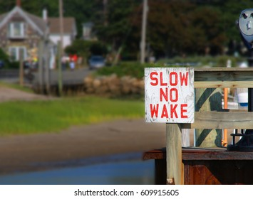 Slow No Wake Sign - Safety First. Boating lane in a harbor
