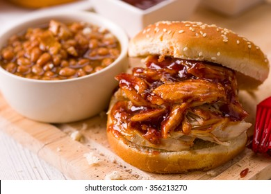 Slow Roasted Pulled Chicken Sandwich with BBQ Sauce and Beans