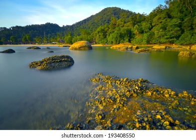 Slow shutter against rocks and blue sky in Pangkor Island, Malaysia