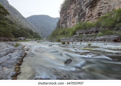 Slow shutter river rapids and dim light in rugged mountain canyon of Rio la Venta in Chiapas, Mexico