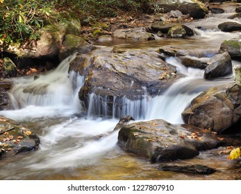 Slow Shutter Speed Image of a Waterfall in a Rocky Georgia Stream in the Fall of the Year