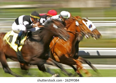 Slow shutter speed rendering of a group of racing jockeys and horses