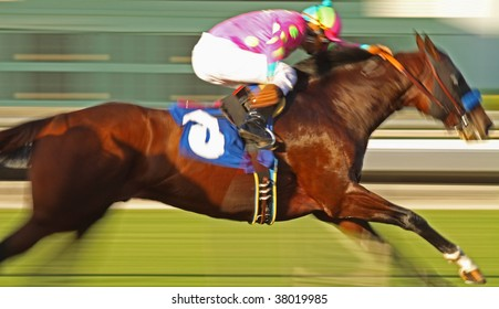 Slow shutter speed rendering of racing horse and jockey with deliberate high saturation