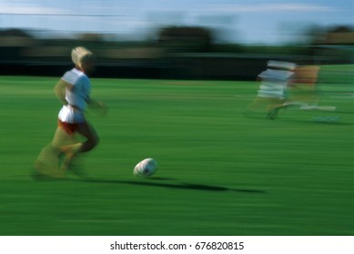 Slow shutter speed showing the fast pace of a soccer game.
