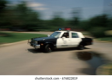 Slow shutter speed showing a police car responding to an emergency.