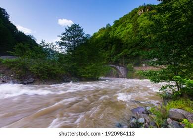 Slow shutter view Firtina Creek and Historical Stone Bridge. Kaçkar Mountains National Park, Rize, Turkey.