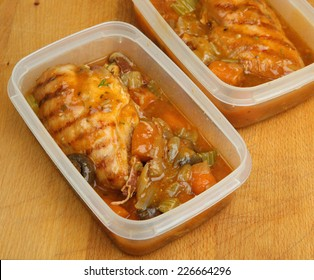 Slow-cooked chicken casserole portions being prepared for chilling or freezing.