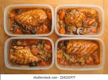 Slow-cooked chicken dinner portions being prepared for freezing or chilling.