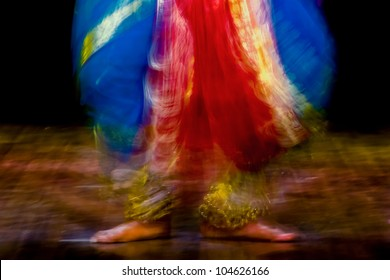 A slow-shutter abstract of  Bharatanatyam dancer in action